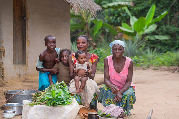 congolese family in front of their house - democratic republic of the congo stock photos and pictures