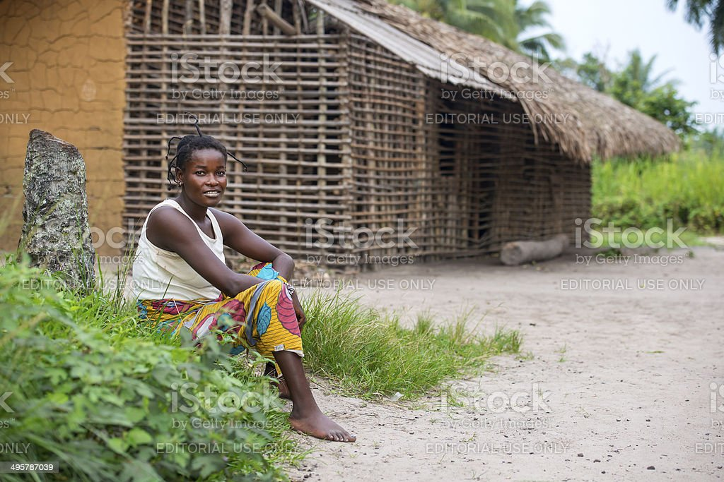 Congolese woman is sitting in front of her house stock photo