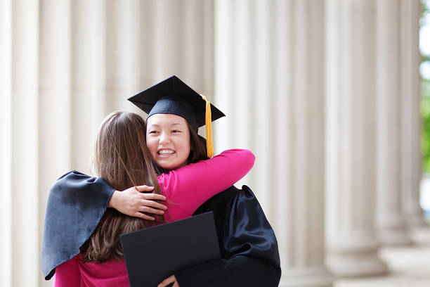 Congratulating Young Graduating Student in Graduation Ceremony Horizontal stock photo