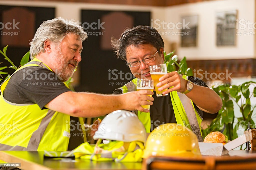 Congratulations Beer Toast With Workmen After High Visibility Clothes Work stock photo