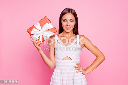 istock Congratulations! Charming cute sweet pretty cheerful glad positive lady receive red case box with white ribbon hold her hand on waist make white smile isolated on bright pastel pink background 1064181648