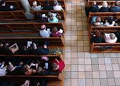 istock Congregation at church praying 175428810