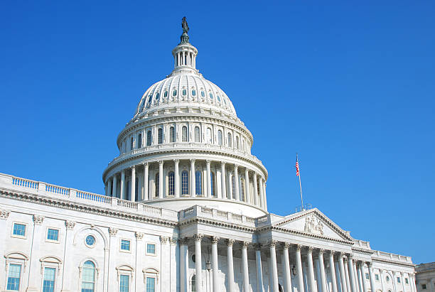 US Congress building in Washington DC and cloudless blue sky The United States Congress state capitol building stock pictures, royalty-free photos & images