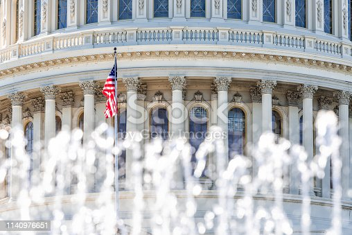 istock US Congress closeup with background of water fountain splashing American flag waving in Washington DC, USA on Capital capitol hill columns pillars 1140976651