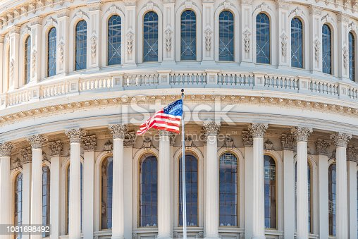 istock US Congress dome closeup with American flag waving in Washington DC, USA on Capital capitol hill, columns, pillars, nobody 1081698492
