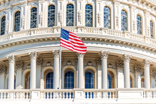 Congress dome with american flag waving in washington dc on capitol picture id1161652369?b=1&k=6&m=1161652369&s=612x612&w=0&h=9jldgzwohk3fm5mhomdlbu uqxqd dis9hjjwk3ddm0=