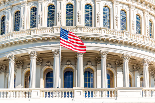 US Congress dome with American flag waving in Washington DC on capitol hill national mall closeup stock photo