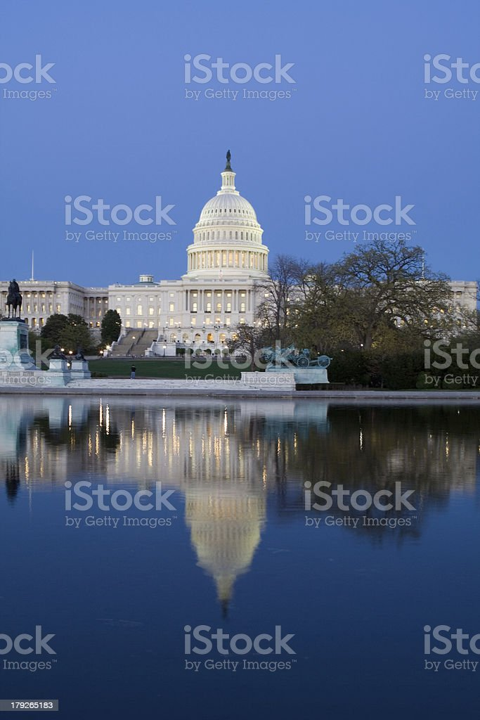 Congress US Capitol at Twilight in Reflecting Pool Blue Sky stock photo