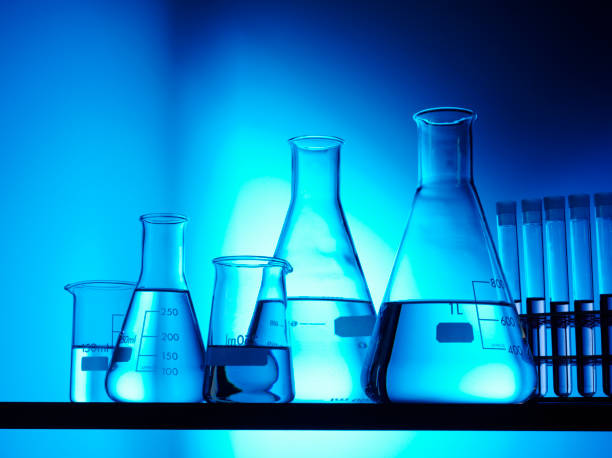 conical flasks and research - beaker stock photos and pictures