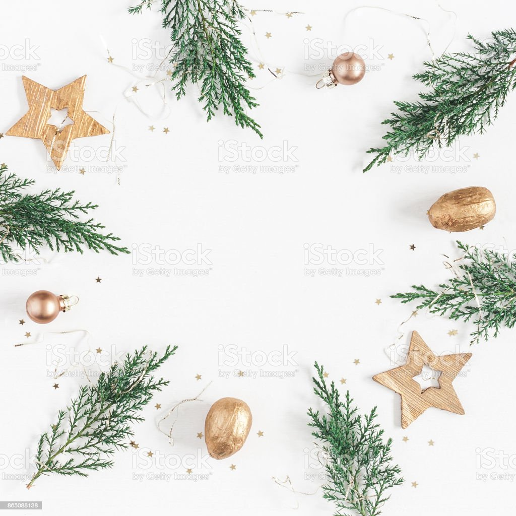 Conifer branches, balls, golden decorations. Flat lay, top view stock photo