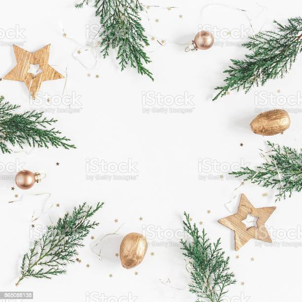 Photo of Conifer branches, balls, golden decorations. Flat lay, top view