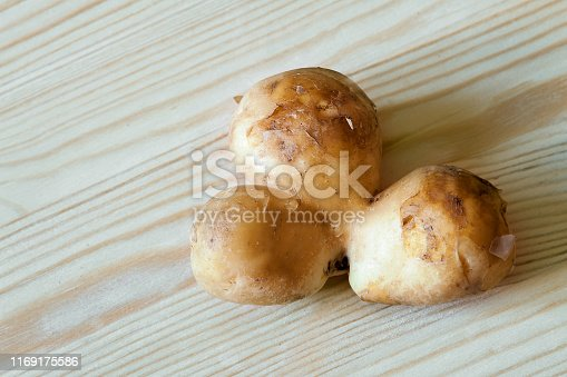 Three conjoined siamese potato on a white background with copy space. Potential use as wonky funny ugly vegetable or food waste concept. Three for the price of one. Buy one get one free