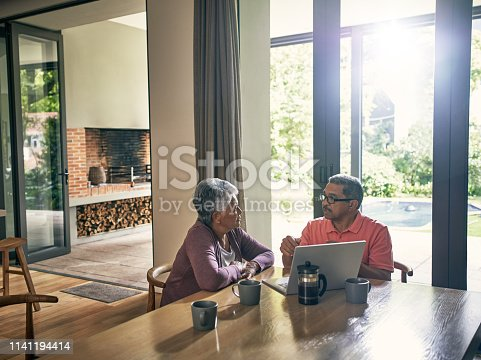 Shot of a mature couple using a laptop together at home