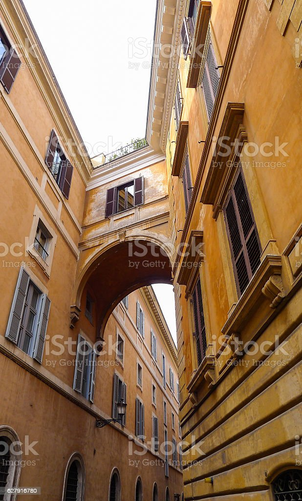 Connected bridge between two building in Rome stock photo