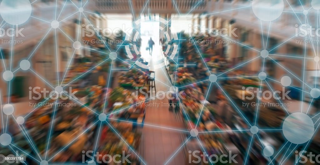 Connected market shopping in smart city stock photo