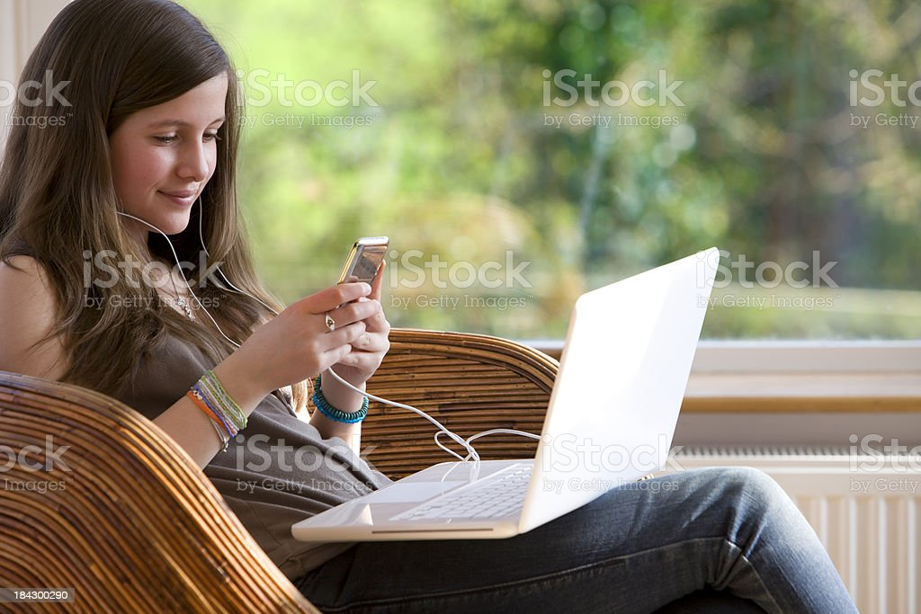 Connected teenager stock photo