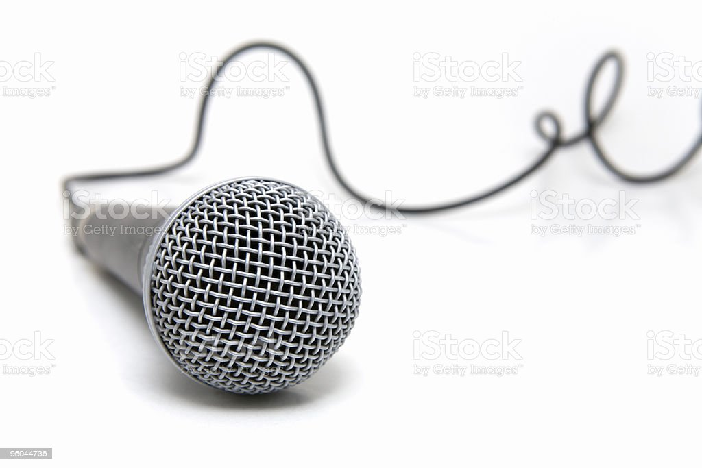 Connected wired microphone in gray Professional microphone with a cable connected Broadcasting Stock Photo