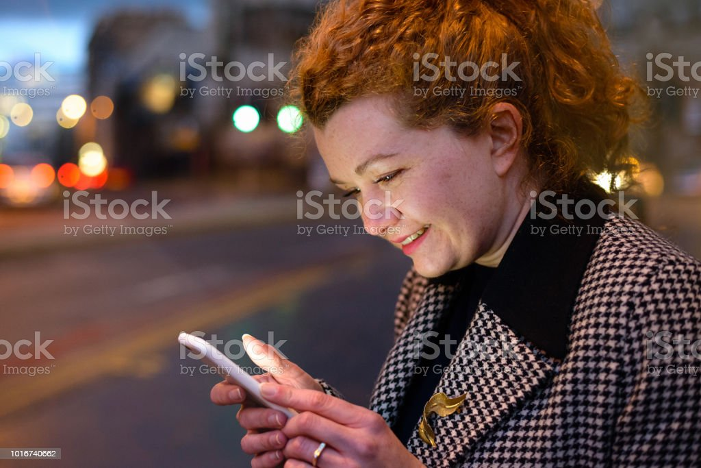 Connected Woman Using Mobile Device stock photo