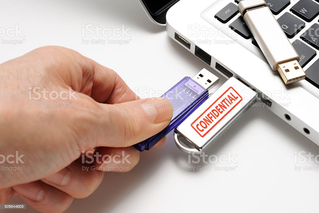 Connecting a confidential USB flash drive with laptop stock photo