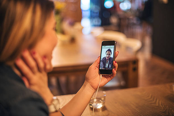 Connecting despite the distance Woman enjoying a video call with her boyfriend. despite stock pictures, royalty-free photos & images