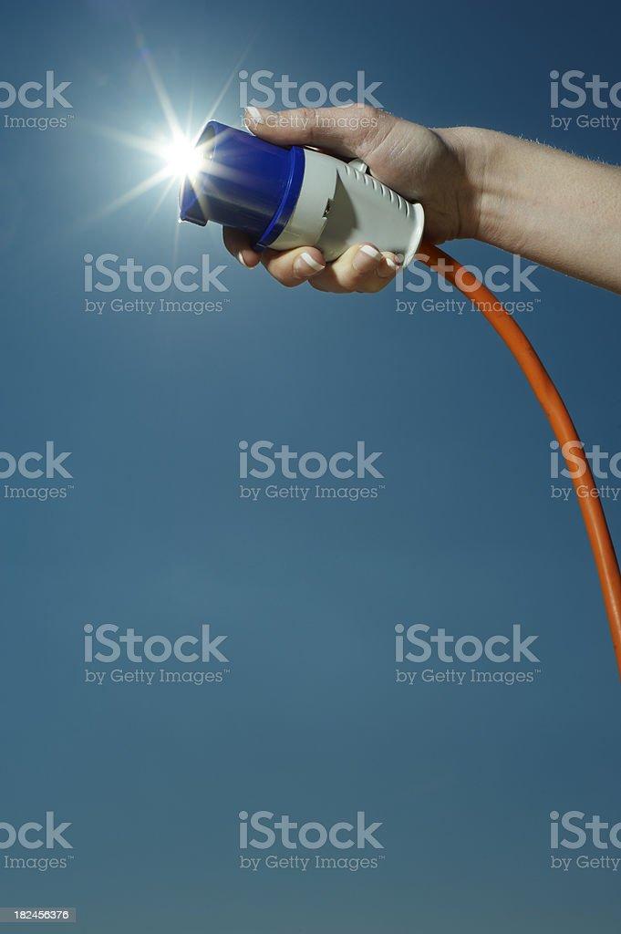 Connecting solar energy plug royalty-free stock photo