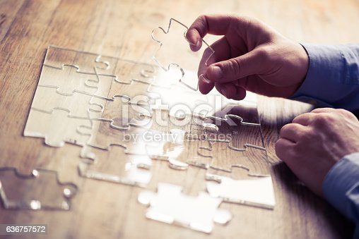 istock Connecting the pieces 636757572