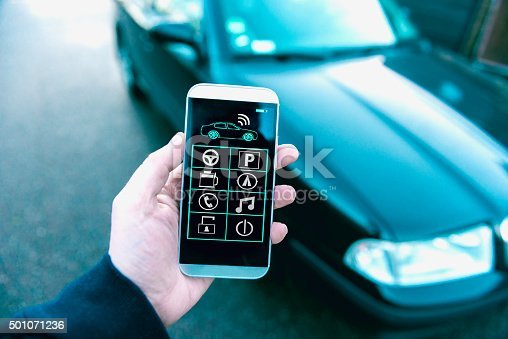 501071464 istock photo Connecting to a car with app on a mobile phone 501071236
