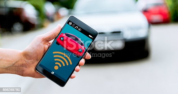 istock Connecting wirelessly to car using mobile app outside 856269780