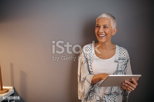 istock Connecting with her old friends 871624818