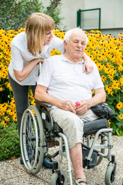 Connection Between The Nurse And Senior Man In The Nursing Home stock photo