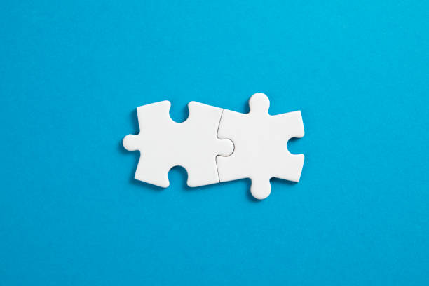 Connection Concept with White Puzzle Pieces stock photo