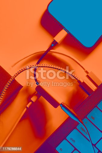 istock Connection of laptop computer and smartphone 1179286544