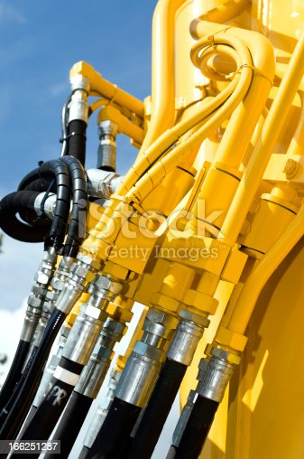 Detail of an excavator. Hydraulic hose connection.