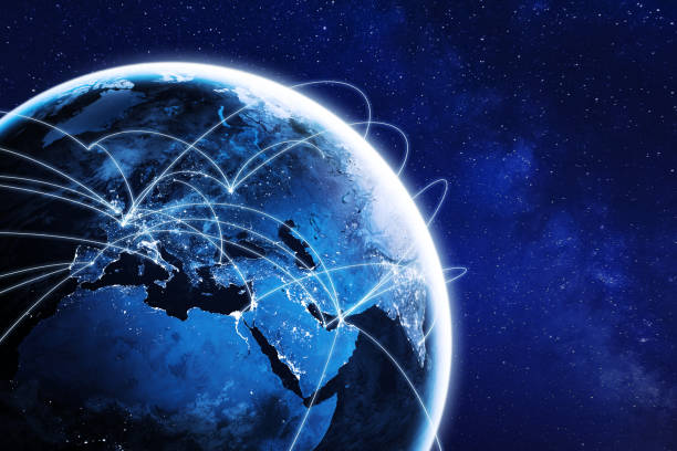 Connections around planet Earth viewed from space at night, cities connected around the globe by shiny lines, international travel or global business finance, world connectivity, elements from NASA stock photo