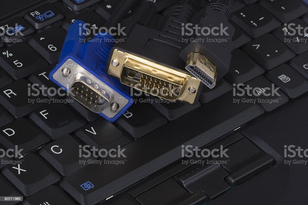 DIV, HDMI, VGA connector on laptop keyboard royalty-free stock photo