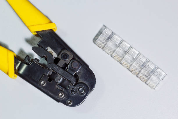 Cтоковое фото Connectors and tool for crimping of internet cable