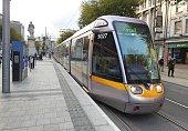 30th April 2020, Dublin, Ireland. A light rail Luas tram train running through O'Connell Street in Dublin city centre.