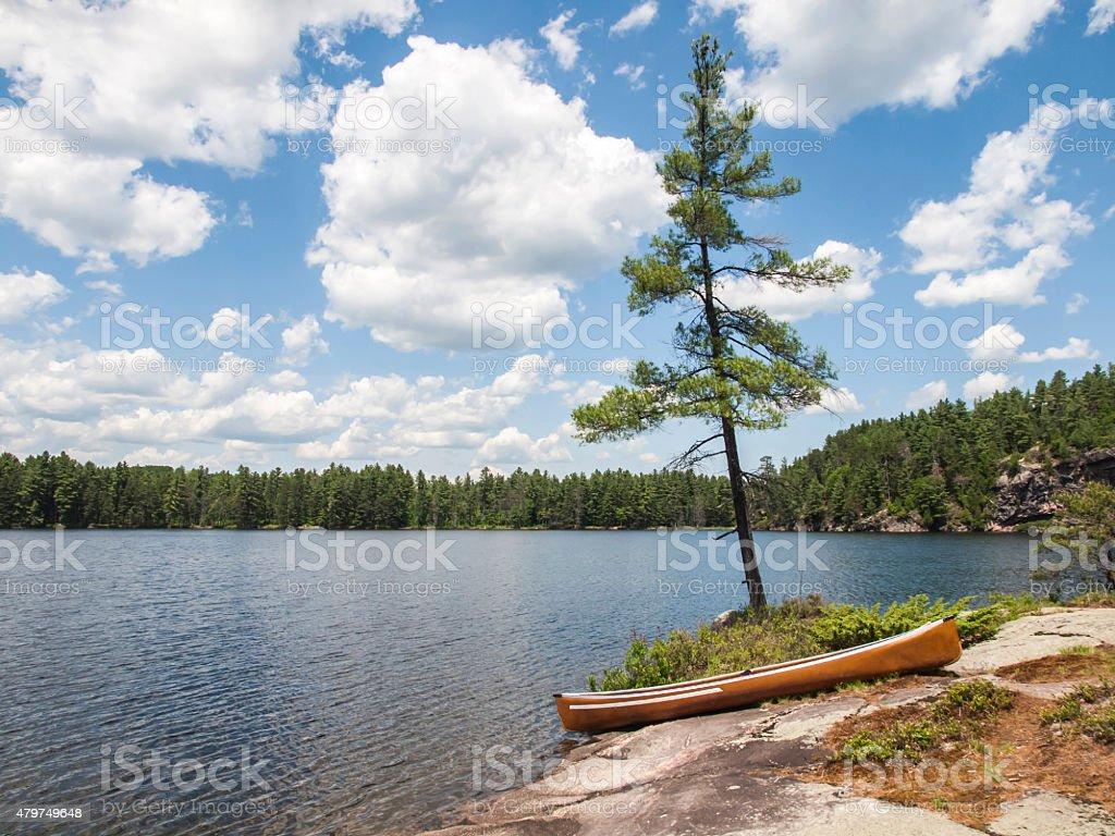 Conoe on rocky shore stock photo