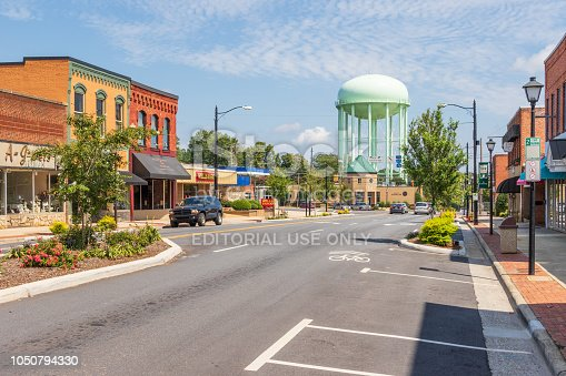 Conover, NC, USA-9/2/18:  The main street of the small, southern town, with city hall and a water tank in the distance.