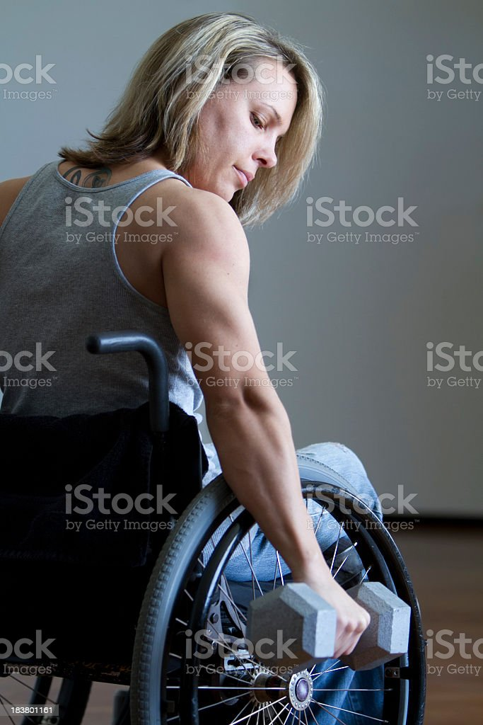 Conquering Adversity - Woman in Wheelchair Working Out stock photo