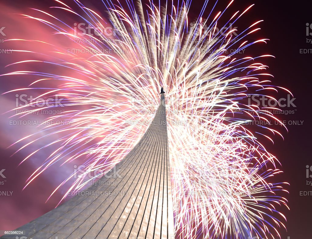 Conquerors of Space Monument in the park outdoors of Cosmonautics museum and fireworks, near VDNK exhibition center, Moscow, Russia stock photo