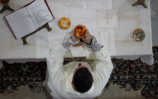 Moment of the consecration of the bread and the sacred wine during the catholic liturgy.