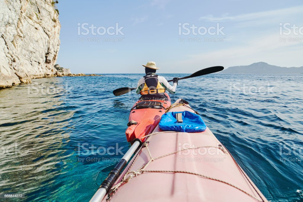 Consecutive sea kayaks on the sea stock photo