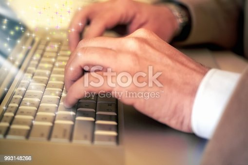 879813798istockphoto Conseptual businessman fingers typing on a laptop keyboard 993148266