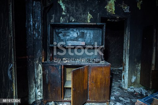 istock Consequences of fire. Interior of the burned by fire house, burned furniture 881912304
