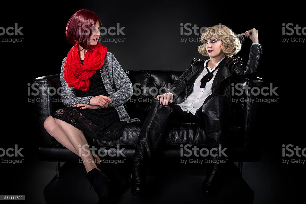 Conservative Classic Fashion Versus Goth Punk Style stock photo