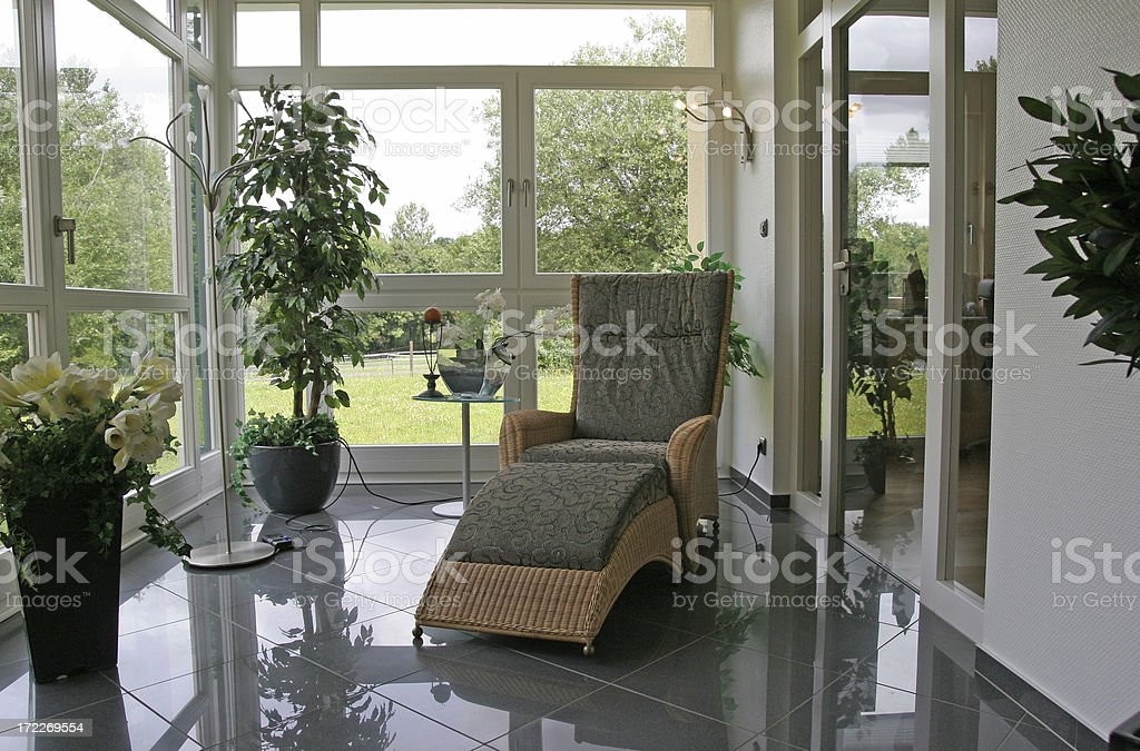 Conservatory with reading armchair stock photo