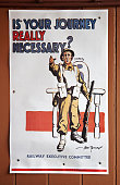 'Bewdley, England - June 21, 2012: Old WW2 railway station poster  on display at Bewdley Railway Station depicting a soldier asking if your journey is really necessary.'