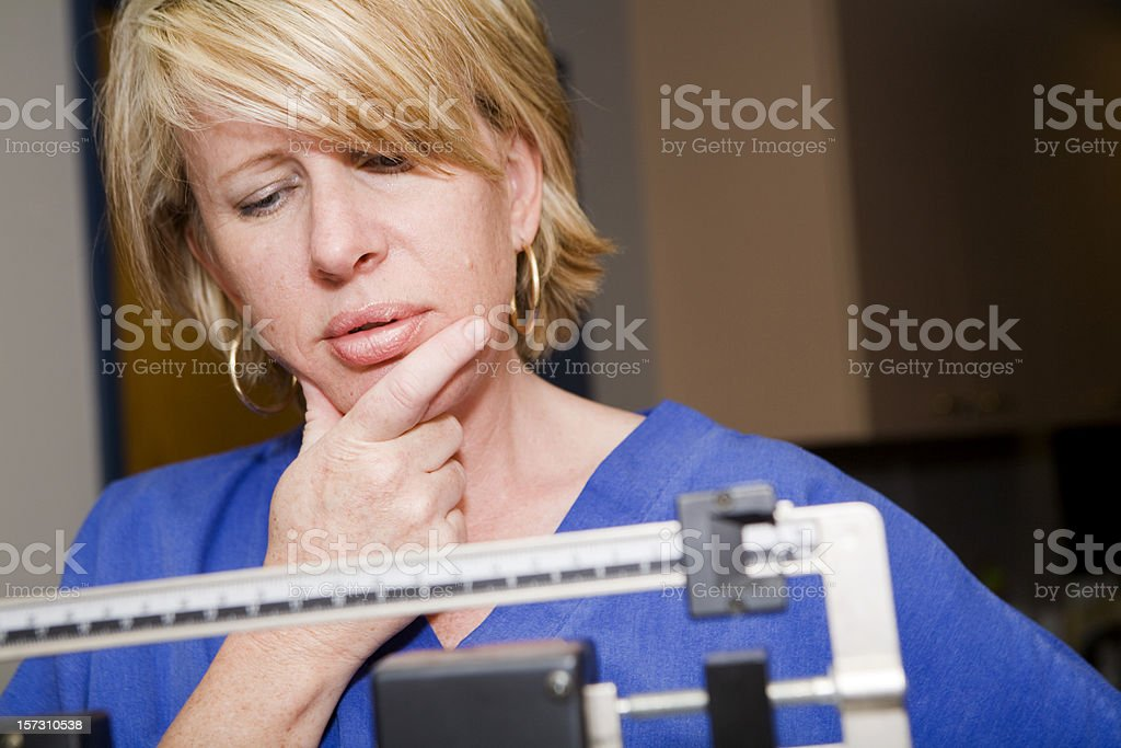 Considering Her Weight stock photo
