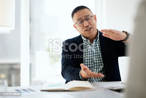 Shot of a businessman and businesswoman having a meeting in a modern office